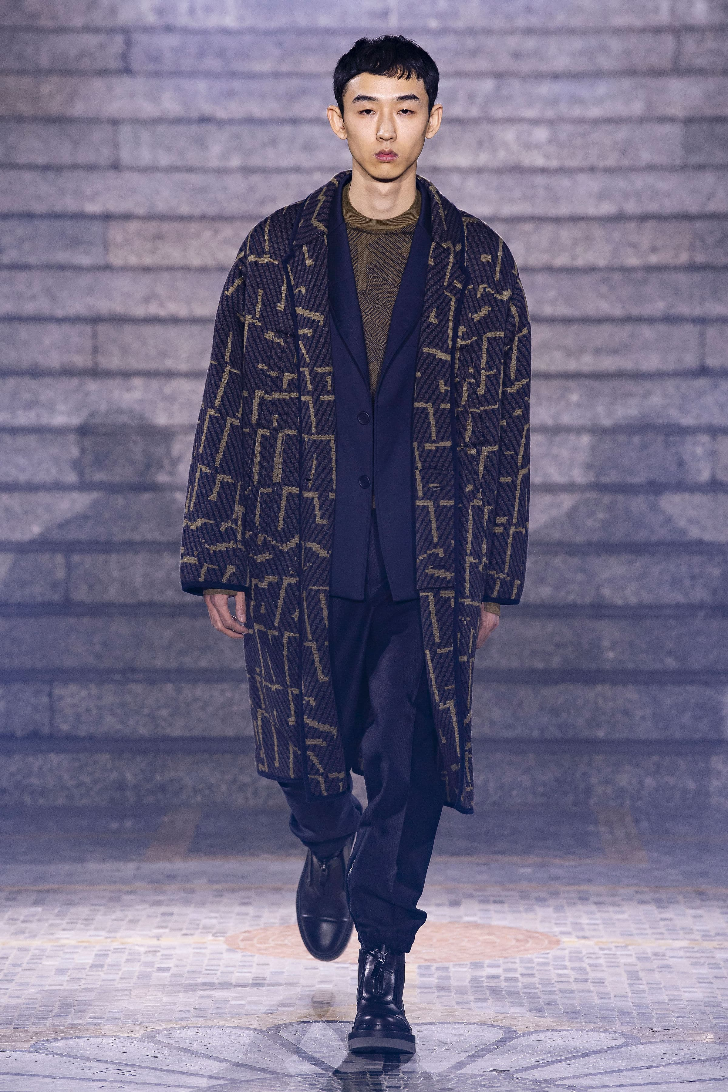Contrasting mustard and purple printed throw-over jacket layered with satin/velvet maroon suit and mustard tee.