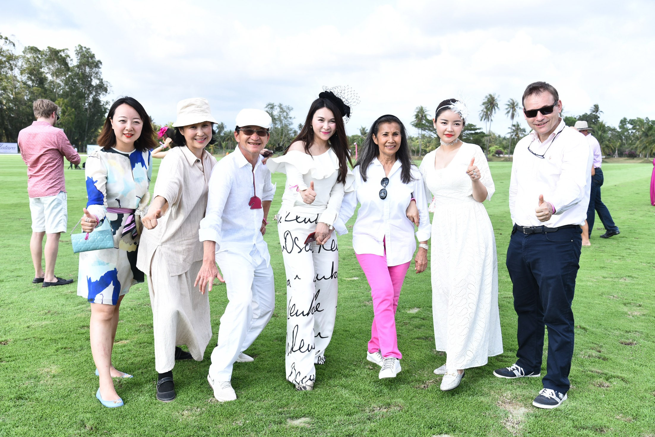 H.E.Georg Schmidt (first right) and Nunthinee Tanner (third right) are seen with 1003 Polo Team fans from China during the divot stomping session