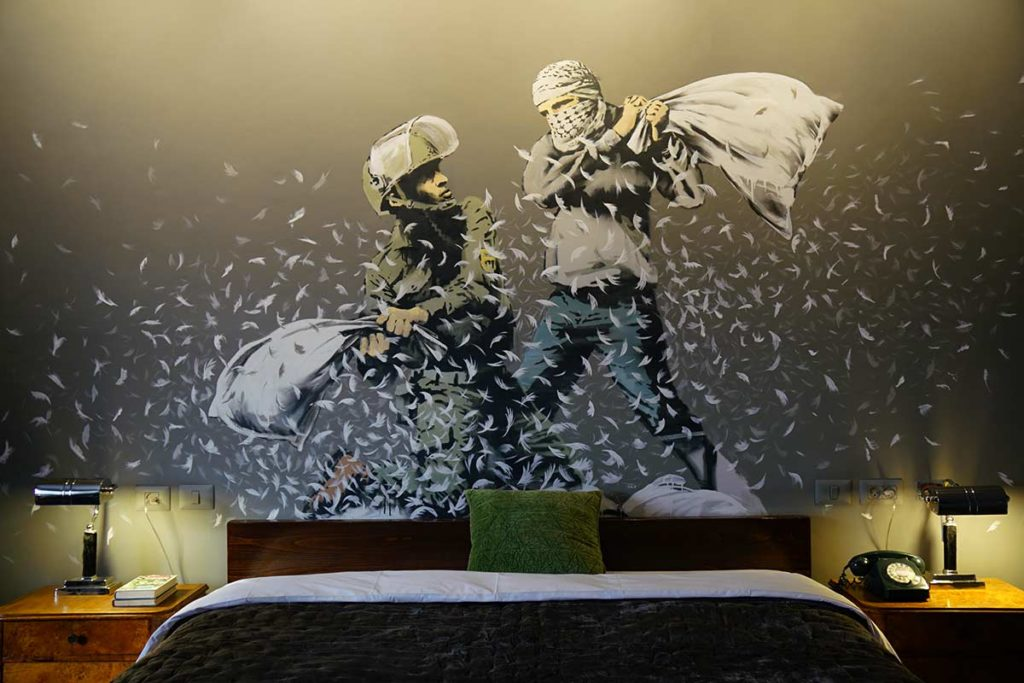 A mural in Walled Off Hotel in Bethlehem. (Image: The Walled Off Hotel)