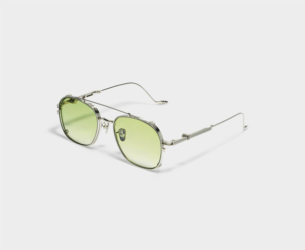 Lone Wolf sunglasses in silver with green lenses. (Photo credit: Gentle Monster)