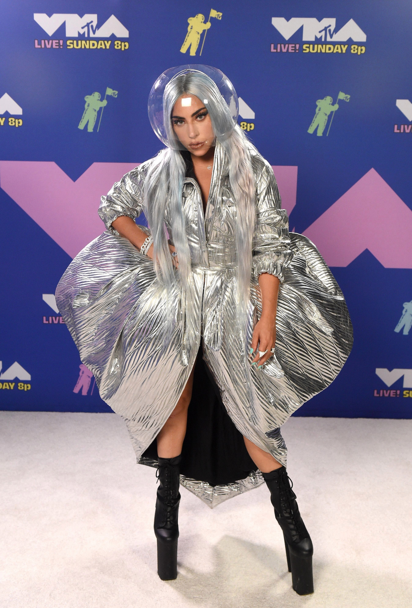 At the 2020 VMAs red carpet, Lady Gaga wore a silver dress by Area and a custom helmet by Conrad by Conrad. (Photo credit: Getty Images)