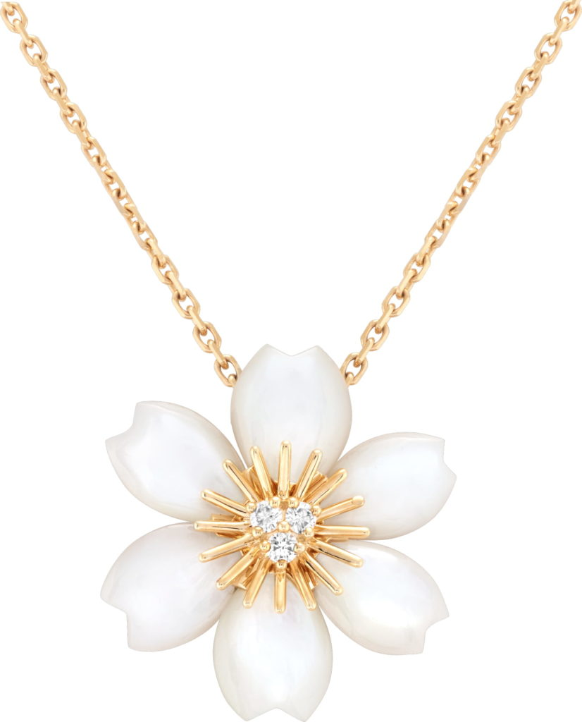 Rose de Noël pendant in yellow gold, white mother-of-pearl and diamonds. (Photo credit: Van Cleef & Arpels)