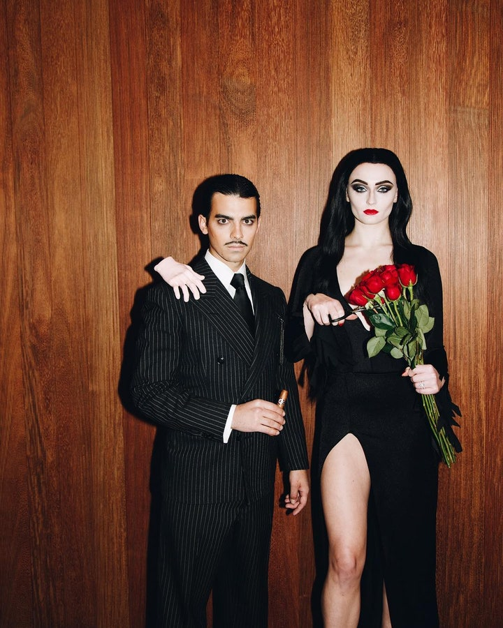 Sophie Turner and Joe Jonas as Morticia and Gomez Addams, as well as The Thing (Photo credit: Sophie Turner / Instagram)