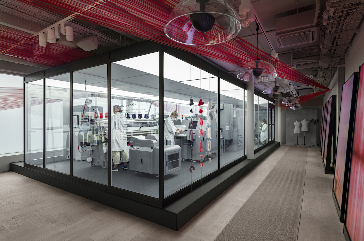 "Inside H&M's Drottninggatan store, which now lets customers see the brand's ""Looop"" recycling process. (Photo credit: H&M)"