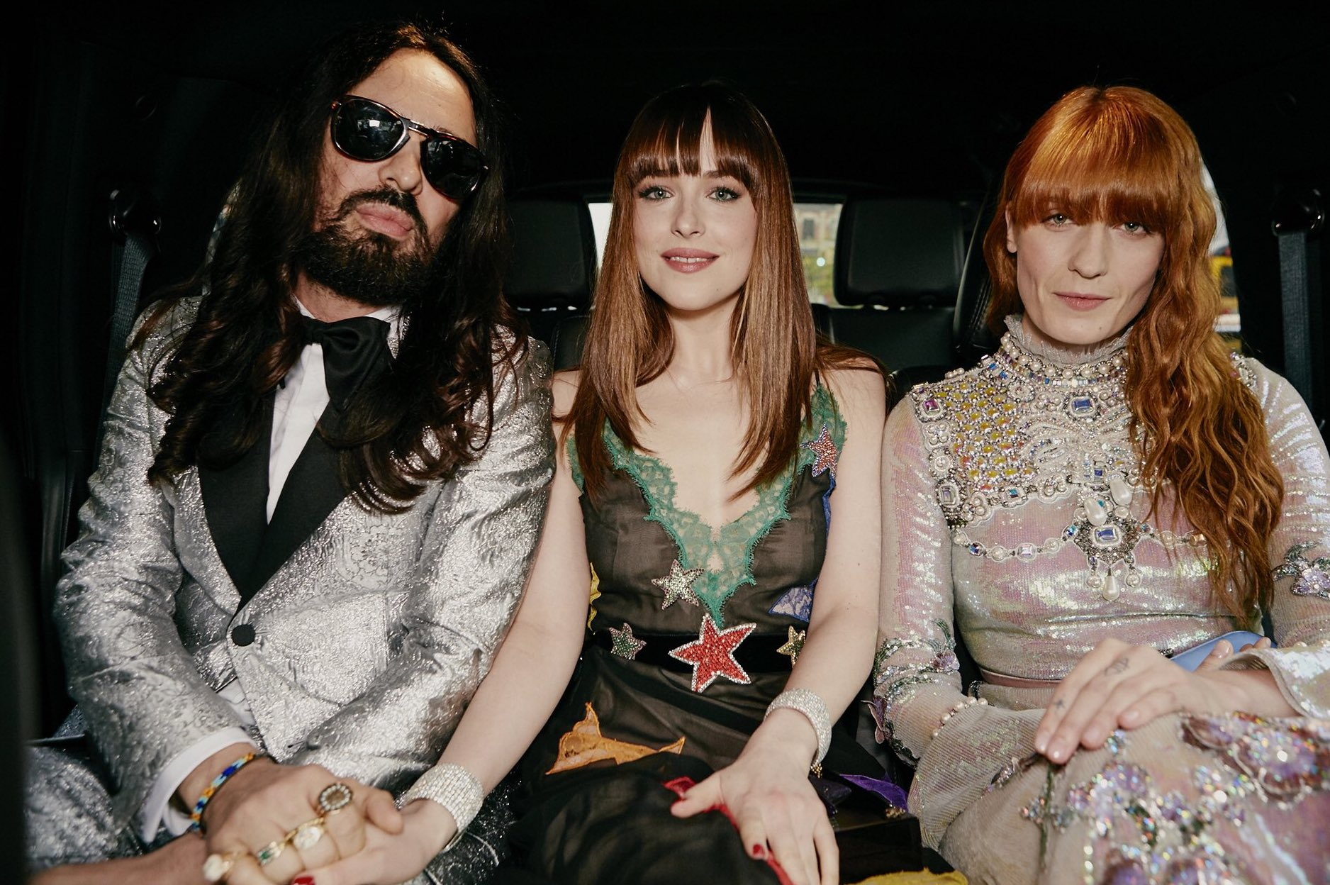 Alessandro Michele with Dakota Johnson and Florence Welch, who will appear in GucciFest. (Photo credit: Gucci / Twitter)