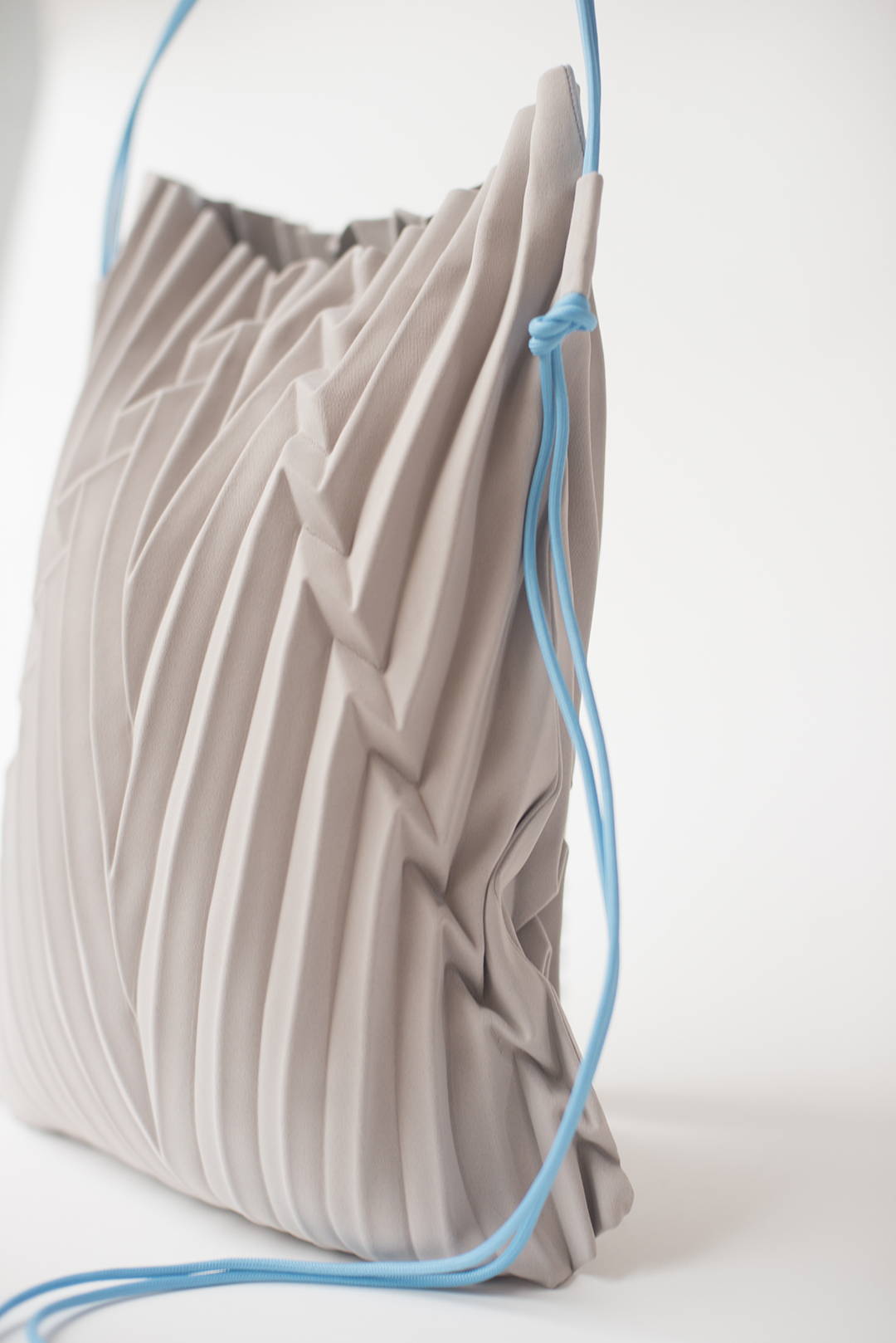 A close-up of a Ginlee Make bag, featuring 'Ivy' pleats. (Photo credit: Ginlee Studio)