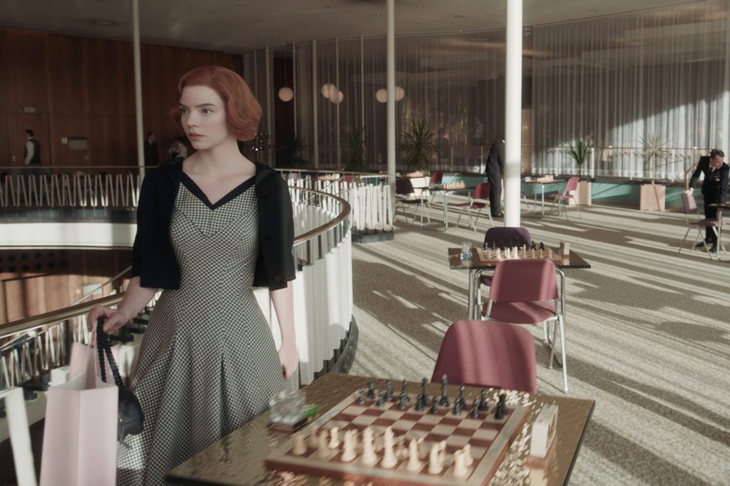The wool gingham fabric of Beth's dress is a nod to the chessboard. (Photo credit: Netflix)