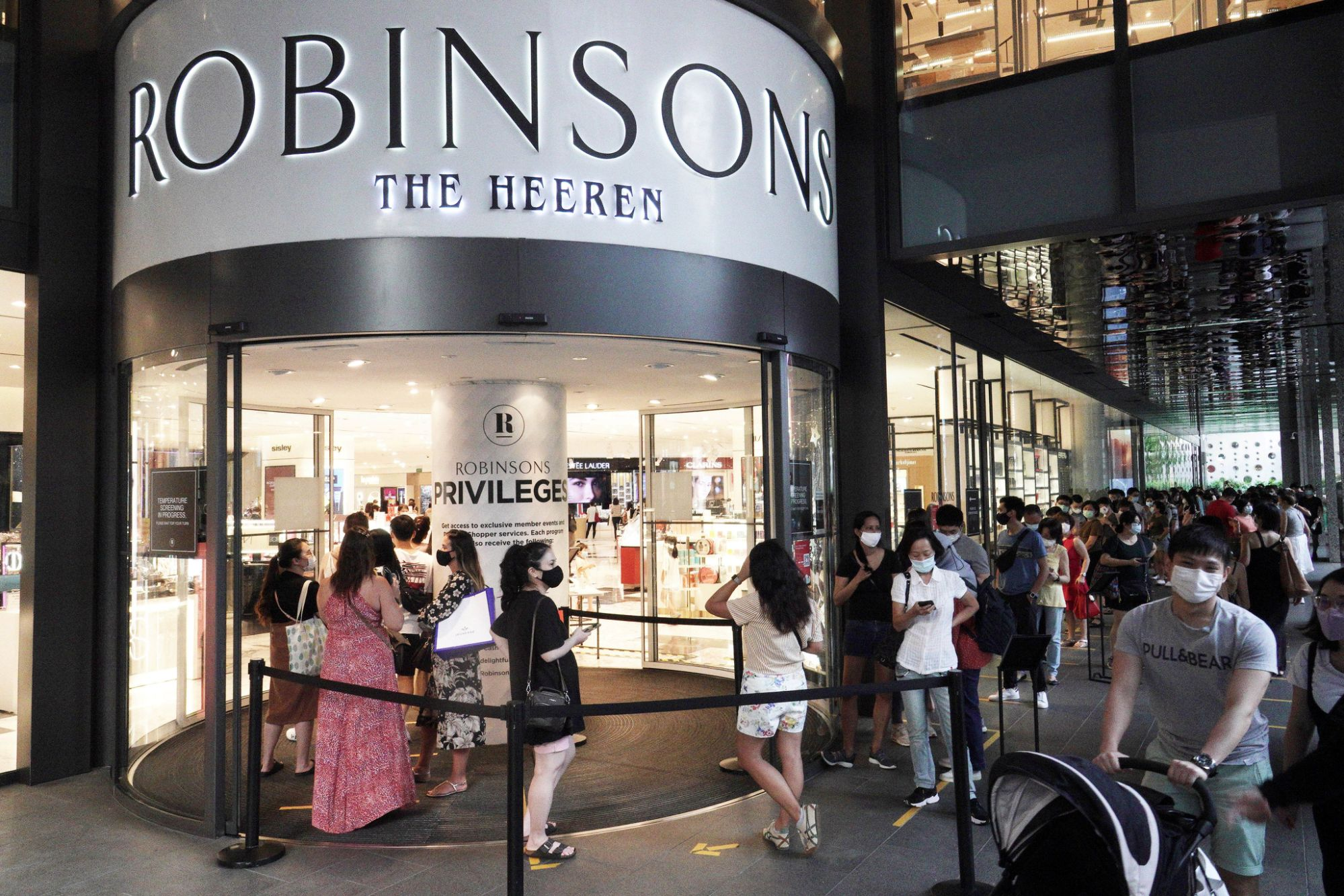 Outside Robinsons at The Heeren, which is now holding a closing sale. (Photo credit: Then Chih Wey/Xinhua via Getty)
