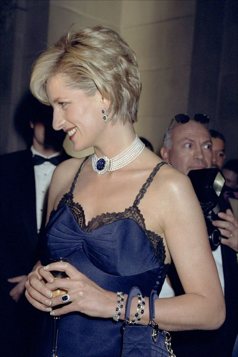 Princess Diana wearing her royal jewellery — including her Marguerite ring and pearl and sapphire choker — months after her divorce from Princes Charles in 1996. (Photo credit: Getty Images)