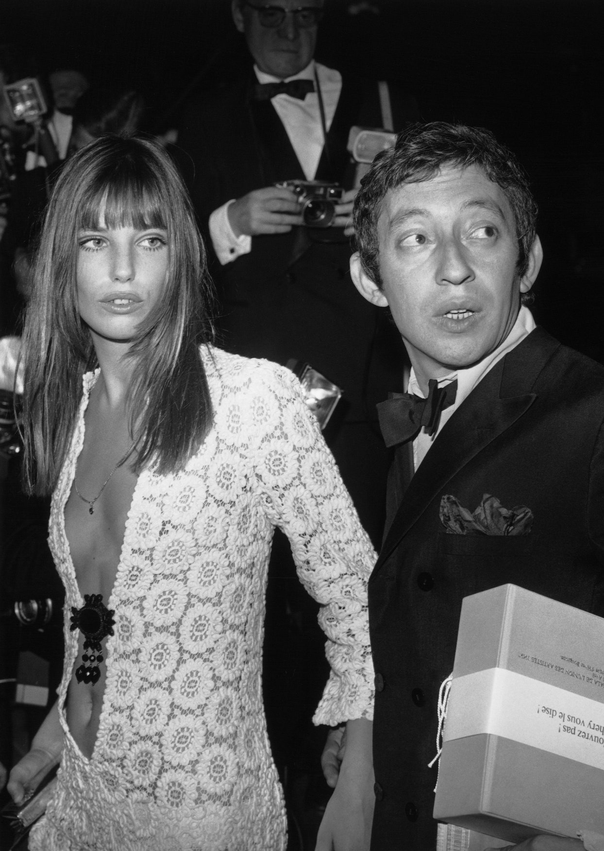 Jane Birkin wearing the now-iconic crochet maxi dress to attend a gala with Serge Gainsbourg. (Photo credit: Getty Images)