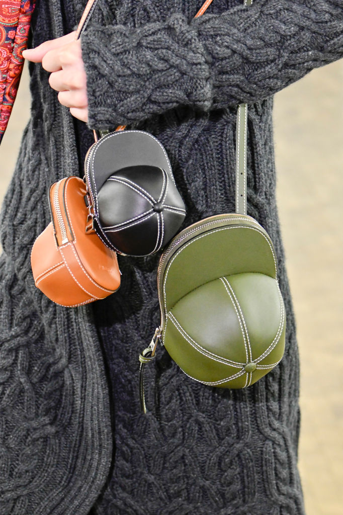Baseball caps as bags at JW Anderson Fall 2020. Image: Courtesy Getty